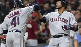 Cleveland Indians designated hitter Edwin Encarnacion celebrates his two-run home run off Houston Astros starting pitcher Charlie Morton with teammate Carlos Santana (41) during the fourth inning of a baseball game, Friday, May 19, 2017, in Houston. (AP Photo/Eric Christian Smith)