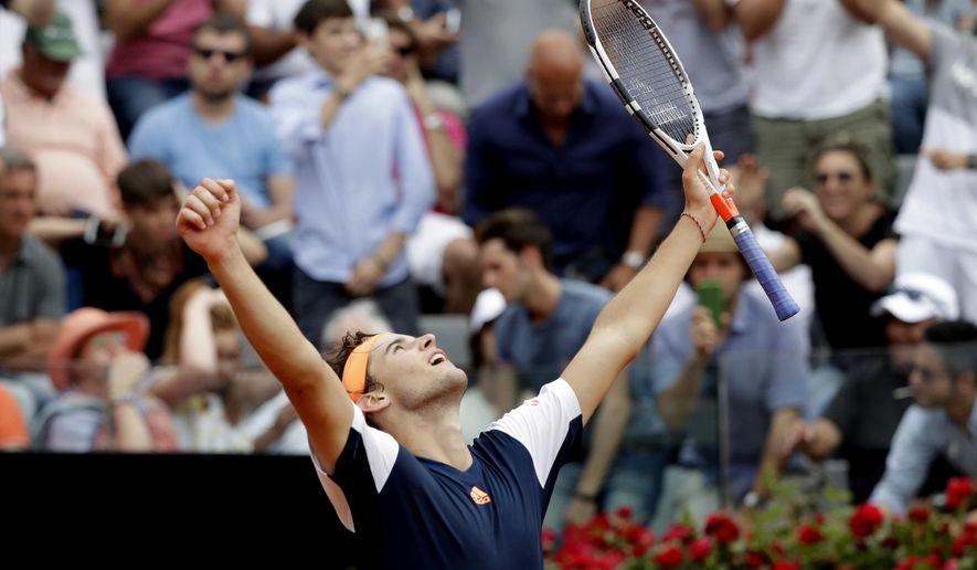 Dominic Thiem of Austria celebrates after beating Rafael Nadal of Spain at the Italian Open tennis tournament, in Rome, Friday, May 19, 2017. (AP Photo/Alessandra Tarantino)