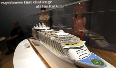 "In this May 18, 2017 photo, visitors look at a model of Royal Caribbean's Oasis of the Seas at an exhibition entitled ""Ocean Liners: Glamour, Speed, and Style"" at the Peabody Essex Museum, in Salem, Mass. The new exhibition of more than 200 artworks from around the globe pays homage to the ocean liner era. (AP Photo/Elise Amendola)"