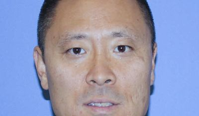 FILE - In this undated file photo provided by the Cincinnati Police Department shows Officer Sonny Kim.  Cincinnati Mayor John Cranley  tearfully apologized, Thursday, May 18, 2017,  to the city's police officers after his office unwittingly approved a proclamation honoring a man suspected of killing Kim in an ambush in June 2015. (Cincinnati Police Department via AP)