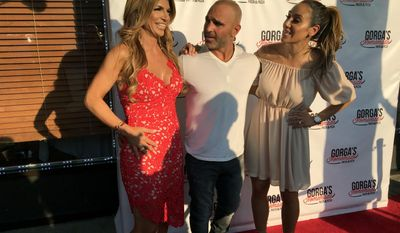 "In this Thursday, May 18, 2017 photo, from left to right, ""Real Housewives of New Jersey"" cast members Teresa Giudice, Joe Gorga and Melissa Gorga pose at the grand opening of Gorga's Homemade Pasta & Pizza restaurant in East Hanover, N.J. (Rob Jennings/NJ Advance Media via AP)"