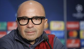 """FILE - In this Dec. 6, 2016, file photo, Sevilla's head coach Jorge Sampaoli looks on during a press conference in Decines, France, ahead of a soccer match against Lyon. Sampaoli says the Argentine soccer federation will negotiate with Spanish club Sevilla to secure his release so he can become the country's national team coach. Sampaoli says """"there is a clear intention by my country to have me as its national coach, and I have had that dream since I was very young."""" (AP Photo/Laurent Cipriani, File)"""