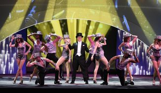 """In this image released by CBS, Stephen Colbert, host of """"The Late Show with Stephen Colbert,"""" appears at the opening production number of the CBS Upfront presentation at Carnegie Hall in New York, Wednesday, May 17, 2017. (Jeffrey R. Staab/CBS via AP)"""