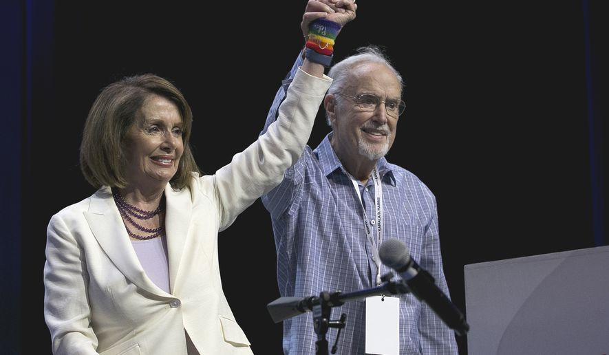 Rep. Nancy Pelosi, D-Calif., and California Democratic Party Chairman John Burton raise their arms together in celebration during the California Democratic Party Convention in Sacramento, Calif., on Saturday, May 20, 2017. California Democrats had tough words for Republican President Donald Trump and the GOP Congress on Saturday as they continued their three-day convention with renewed optimism about their party's chances of tipping the balance of power in the U.S. House. (AP Photo/Rich Pedroncelli)