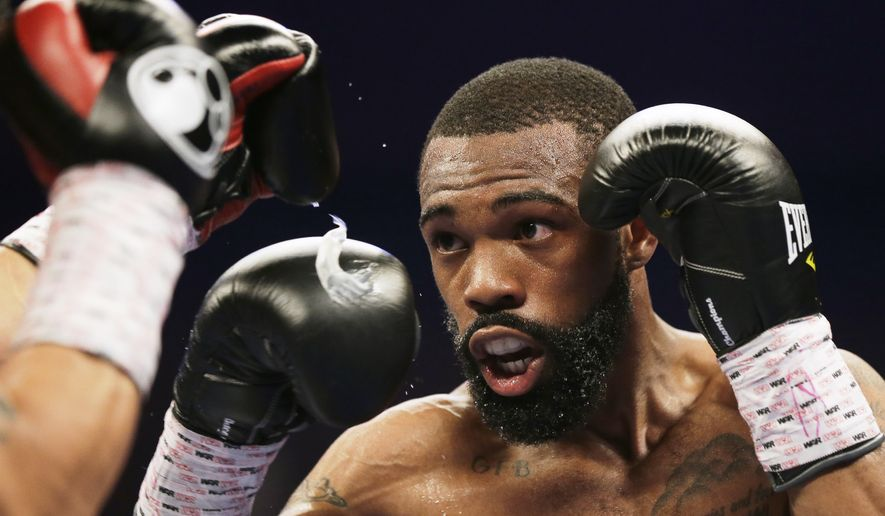 Gary Russell Jr. prepares to throw a jab at Oscar Escandon during the WBC featherweight title fight in Oxon Hill, Md., Saturday, May 20, 2017. (AP Photo/Mark Tenally)