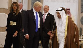 President Donald Trump and first lady Melania Trump walk with Saudi King Salman to a coffee ceremony and presentation ceremony of The Collar of Abdulaziz Al Saud Medal at the Royal Court Palace, Saturday, May 20, 2017, in Riyadh. (AP Photo/Evan Vucci)