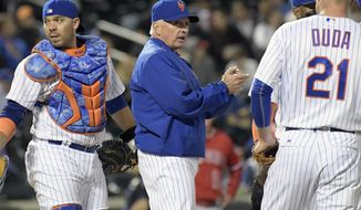 New York Mets manager Terry Collins, center, changes pitchers during the fifth inning of a baseball game against the Los Angeles Angels, Saturday, May 20, 2017, at Citi Field in New York. (AP Photo/Bill Kostroun)