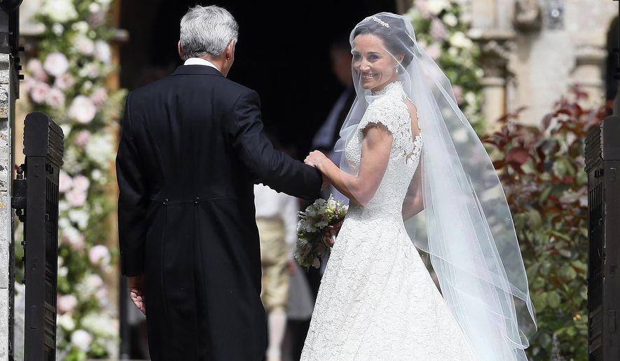 Pippa Middleton arrives with her father Michael Middleton for her wedding to James Matthews at St Mark's Church in Englefield, England Saturday, May 20, 2017. Middleton, the sister of Kate, Duchess of Cambridge is to marry hedge fund manager James Matthews in a ceremony Saturday where her niece and nephew Prince George and Princess Charlotte are in the wedding party, along with sister Kate and princes Harry and William. (AP Photo/Kirsty Wigglesworth, Pool)