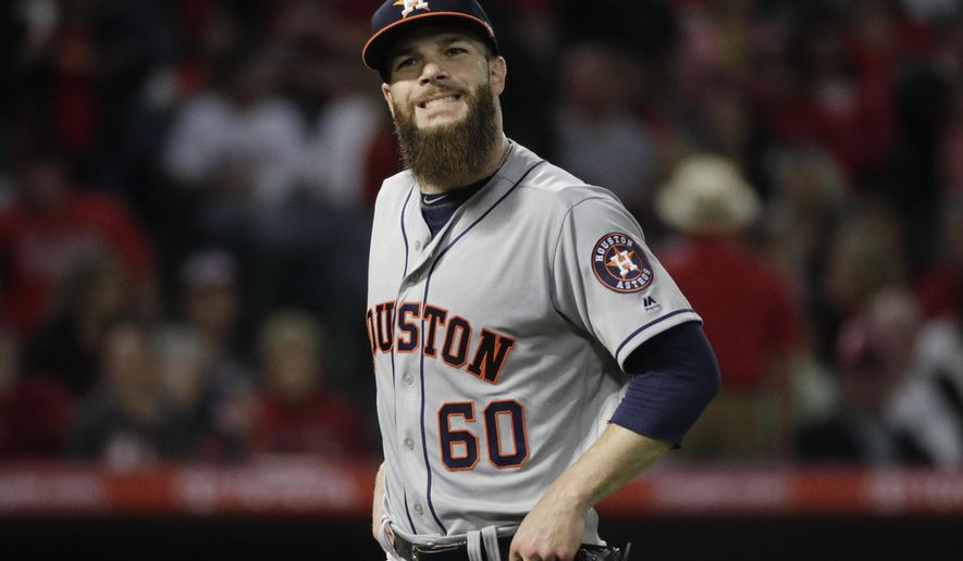 FILE - In this Friday, May 5, 2017, file photo, Houston Astros starting pitcher Dallas Keuchel walks toward the dugout after the second inning of a baseball game against the Los Angeles Angels, in Anaheim, Calif. The Astros have placed Keuchel on the 10-day disabled list with a pinched nerve in his neck. (AP Photo/Jae C. Hong, File)