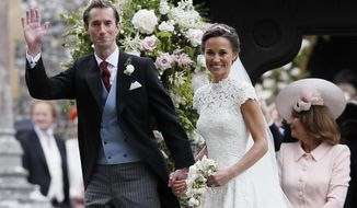 Pippa Middleton and James Matthews smile for the cameras after their wedding at St Mark's Church in Englefield, England Saturday, May 20, 2017. Middleton, the sister of Kate, Duchess of Cambridge married hedge fund manager James Matthews in a ceremony Saturday where her niece and nephew Prince George and Princess Charlotte was in the wedding party, along with sister Kate and princes Harry and William. (AP Photo/Kirsty Wigglesworth, Pool)