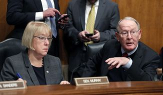 In this Jan. 31, 2017, file photo, Senate Health, Education, Labor, and Pensions Committee Chairman Sen. Lamar Alexander, R-Tenn., accompanied by the committee's ranking member Sen. Patty Murray, D-Wash. speaks on Capitol Hill in Washington. (AP Photo/Alex Brandon, File)
