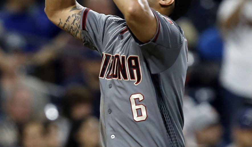 Arizona Diamondbacks' David Peralta raises his hands to the sky after hitting a solo home run against the San Diego Padres during the sixth inning of a baseball game in San Diego, Friday, May 19, 2017. (AP Photo/Alex Gallardo)