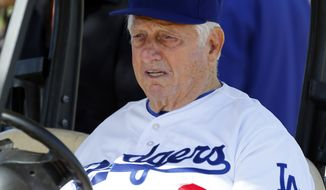 FILE - In this Feb. 14, 2014, file photo, former Los Angeles Dodgers manager Tommy Lasorda watches during spring training baseball practice in Glendale, Ariz. Los Angeles Dodgers say Hall of Fame manager Tom Lasorda has been hospitalized. The team says the 89-year-old is resting comfortably, but didn't provide any additional details on his condition, Saturday, May 20, 2017. (AP Photo/Paul Sancya, File)