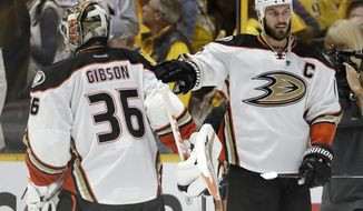 Anaheim Ducks center Ryan Getzlaf (15) congratulates goalie John Gibson (36) after the Ducks beat the Nashville Predators in overtime in Game 4 of the Western Conference final in the NHL hockey Stanley Cup playoffs Thursday, May 18, 2017, in Nashville, Tenn. The Ducks won 3-2 to even the series 2-2. (AP Photo/Mark Humphrey)
