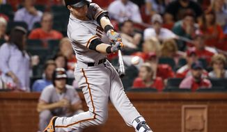 San Francisco Giants' Christian Arroyo hits a two-run double during the 13th inning of a baseball game against the St. Louis Cardinals, Saturday, May 20, 2017, in St. Louis. (AP Photo/Jeff Roberson)