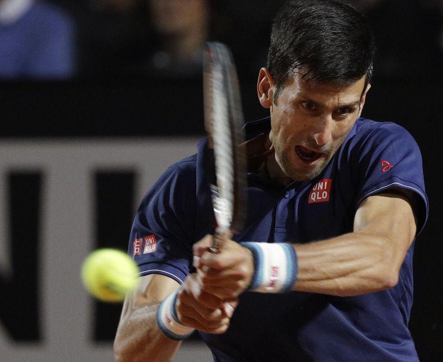 Serbia's Novak Djokovic returns the ball to Argentina's Juan Martín del Potro during a quarter finals match at the Italian Open tennis tournament, in Rome, Friday, May 19, 2017. (AP Photo/Gregorio Borgia)