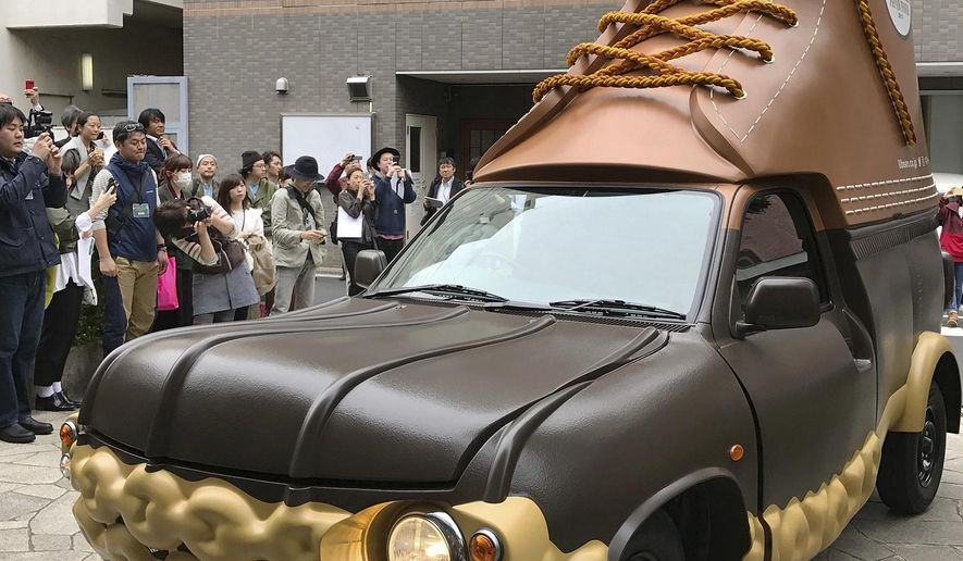In this April 26, 2017 photo provided by L.L. Bean, the company's Bootmobile is displayed in Tokyo, Japan. The Maine-based outdoors company already has two of the rolling Bean boots in the U.S. Now this third version will be visiting Bean's stores in Japan. (Hideki Hashiramoto/L.L.Bean via AP)