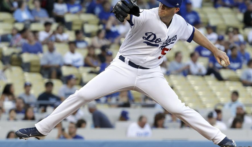 Los Angeles Dodgers starting pitcher Alex Wood throws against the Miami Marlins during the first inning of a baseball game in Los Angeles, Friday, May 19, 2017. (AP Photo/Chris Carlson)