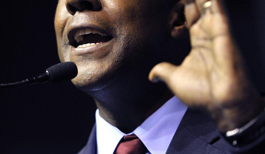 In this June 4, 2011 file photo, Newton Mayor Setti Warren addresses delegates during the Democratic Convention at the Tsongas Arena in Lowell, Mass.  Warren is jumping into the race for Massachusetts governor, joining two other Democratic candidates hoping to unseat Republican Gov. Charlie Baker in next year's election. Warren made the announcement Saturday, May 20, 2017  in front of his home in Newton to a gathering of supporters.(AP Photo/Josh Reynolds)