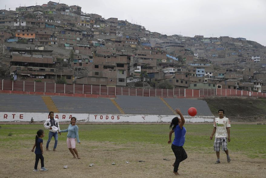 In this May 14, 2017 photo, people play ball inside of the venue that will host baseball, softball, archery and other sports during the 2019 Pan American Games in Lima, Peru. Peru is organizing the largest sports event in its history, in the wake of the worst flooding in its history. (AP Photo/Martin Mejia)