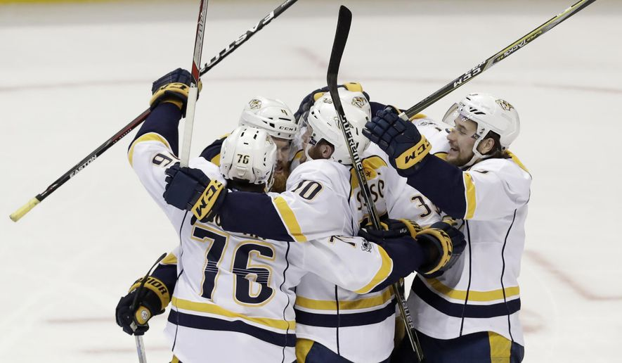 Nashville Predators celebrate after Colin Wilson scored against the Anaheim Ducks during the second period of Game 5 in the NHL hockey Stanley Cup Western Conference finals in Anaheim, Calif., Saturday, May 20, 2017. (AP Photo/Chris Carlson)