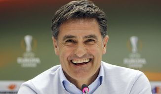 FILE - In this Wednesday Feb. 17, 2016 file photo, Marseille's Spanish coach Jose Miguel Gonzalez, Michel, smiles during a press conference at the Velodrome stadium, in Marseille, southern France. Real Madrid enters the final round of the Spanish league season just one point away from ending a five-year wait to reclaim the domestic crown. Standing in its way is a Malaga side that has found its stride under former Madrid player Michel Gonzalez. (AP Photo/Claude Paris, File)