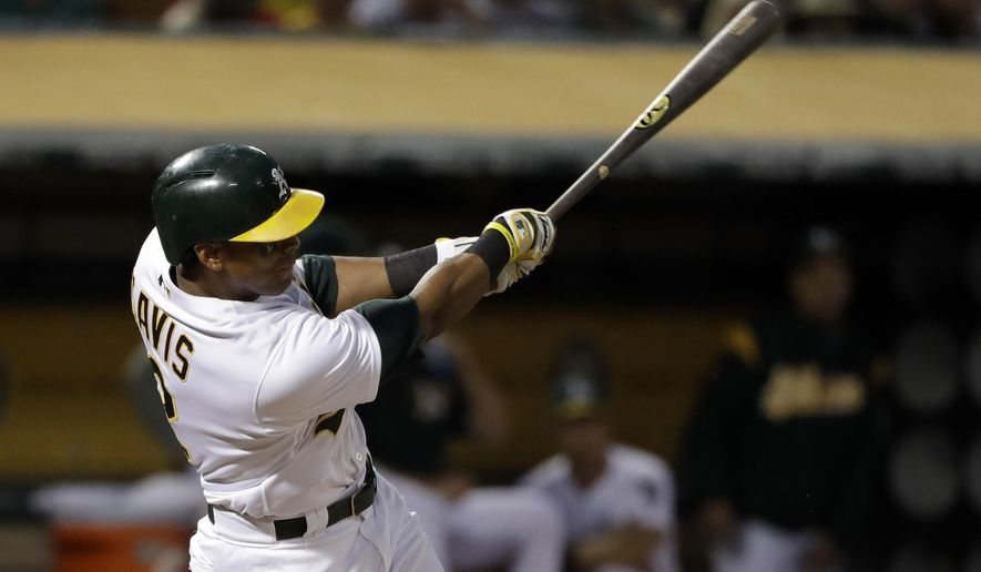 Oakland Athletics' Khris Davis drives in a run with a double against the Boston Red Sox during the sixth inning of a baseball game Friday, May 19, 2017, in Oakland, Calif. (AP Photo/Marcio Jose Sanchez)