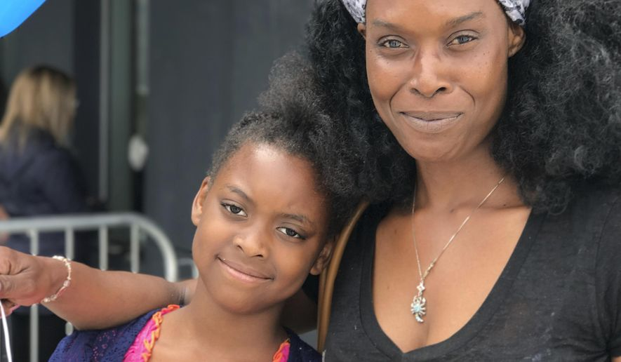 Clarissa Williams, of West Hempstead, N.Y., poses with her daughter Nylah, 8, after seeing one of the final shows of Ringling Brothers and Barnum & Bailey circus at the Nassau Veteran's Memorial Coliseum in Uniondale, N.Y., Saturday, May 20, 2017. Williams is a lifelong circus fan and hopes her daughter will remember the show. (AP Photo/Tamara Lush)