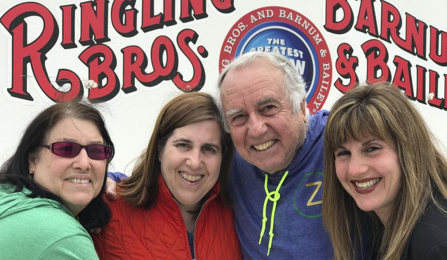 Gene Goldstein, center right, and his family stop for a photo outside the Nassau Veteran's Memorial Coliseum in Uniondale, N.Y., which is hosting the final performances of the Ringling Brothers and Barnum & Bailey Circus, Saturday, May 20, 2017. From left are Cheryl Goldstein, Dawn Mirowitz, Gene Goldstein and Heather Greenberg. (AP Photo/Tamara Lush)