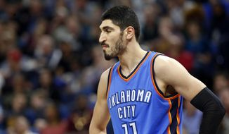 FILE - In this April 11, 2017, file photo, Oklahoma City Thunder's Enes Kanter, of Turkey, looks on during a break in the second half of an NBA basketball game against the Minnesota Timberwolves in Minneapolis. Kanter is returning to the United States after being detained in a Romanian airport. Romanian Border Police spokesman Fabian Badila confirmed to The Associated Press that the player left Romania for the United States via London. Kanter, who is from Turkey, said in a video Saturday morning, May 20, 2017, on his Twitter account that the Turkish embassy canceled his passport and he'd been detained for several hours at a Romanian airport. (AP Photo/Jim Mone, File)