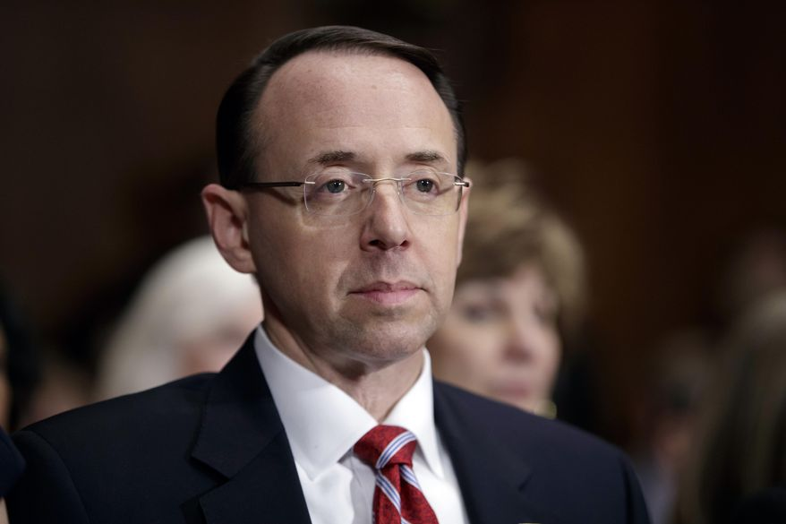 In this March 7, 2017, file photo, then-Deputy Attorney General-designate Rod Rosenstein, listens on Capitol Hill in Washington, during his confirmation hearing before the Senate Judiciary Committee. Rosenstein has told members of Congress he stands by a memo he wrote that preceded the president's firing of FBI Director James Comey. (AP Photo/J. Scott Applewhite, File)