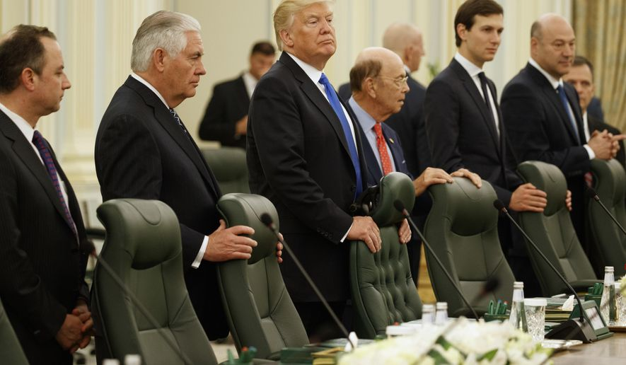 President Donald Trump waits for the beginning of a bilateral meeting with Saudi King Salam at the Royal Court Palace, Saturday, May 20, 2017, in Riyadh. From left are, White House chief of staff Reince Priebus, Secretary of State Rex Tillerson, Trump, Commerce Secretary Wilbur Ross, White House senior adviser Jared Kushner, and Chief Economic Adviser Gary Cohn. (AP Photo/Evan Vucci)