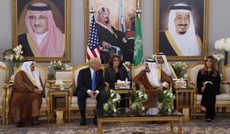 President Donald Trump meets with Saudi King Salman after a welcome ceremony at the Royal Terminal of King Khalid International Airport, Saturday, May 20, 2017, in Riyadh. (AP Photo/Evan Vucci)