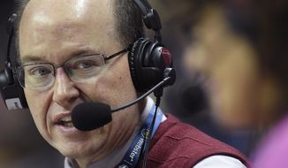 In this Feb. 11, 2017, photo, Bob Joyce, the radio play-by-play voice of the UConn women's basketball team, calls a game between UConn and SMU in Storrs, Conn. Joyce has called six national championship games as the radio voice of the UConn women's basketball team, but in the offseason he calls balls and strikes, pursuing his other passion as a high school baseball umpire. (Brad Horrigan/The Hartford Courant via AP)