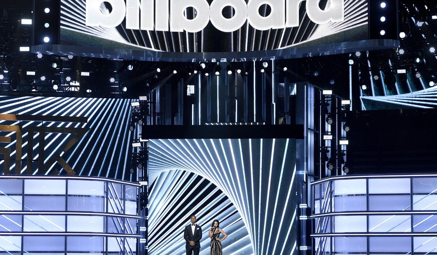 Hosts Ludacris, left, and Vanessa Hudgens speak at the Billboard Music Awards at the T-Mobile Arena on Sunday, May 21, 2017, in Las Vegas. (Photo by Chris Pizzello/Invision/AP)