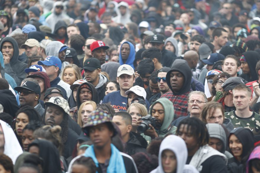Marijuana enthusiasts light up at 4:20 p.m. MDT to mark the 4/20 holiday on Thursday, April 20, 2017, in Denver's Civic Center Park. The annual celebration of cannabis culture attracted users from across the intermountain West to Denver.  (AP Photo/David Zalubowski)