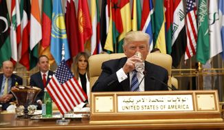 President Donald Trump takes a drink of water before delivering a speech to the Arab Islamic American Summit, at the King Abdulaziz Conference Center, Sunday, May 21, 2017, in Riyadh, Saudi Arabia. (AP Photo/Evan Vucci)
