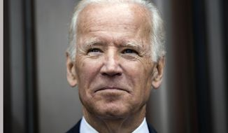 """FILE- In this April 19, 2017, file photo, former Vice President Joe Biden attends the opening ceremony for Museum of the American Revolution in Philadelphia. Biden spoke to graduates Sunday, May 21, at Maine's Colby College, urging them to resist the impulse to throw up their hands after an election that played to society's """"baser instincts."""" He told his audience they have a role to play in making things better, and said it's time for Americans to """"regain our sense of unity and purpose."""" (AP Photo/Matt Rourke, File)"""