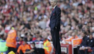 Arsenal manager Arsene Wenger looks dejected during the English Premier League soccer match between Arsenal and Everton at The Emirates stadium in London, Sunday May 21, 2017. (AP Photo/Tim Ireland)