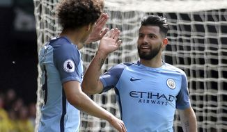 Manchester City's Sergio Aguero, right, celebrates scoring his team's third goal, during the English Premier League soccer match between Manchester City and Watford, at Vicarage Road, in Watford, England. (Steven Paston/PA/ via AP)