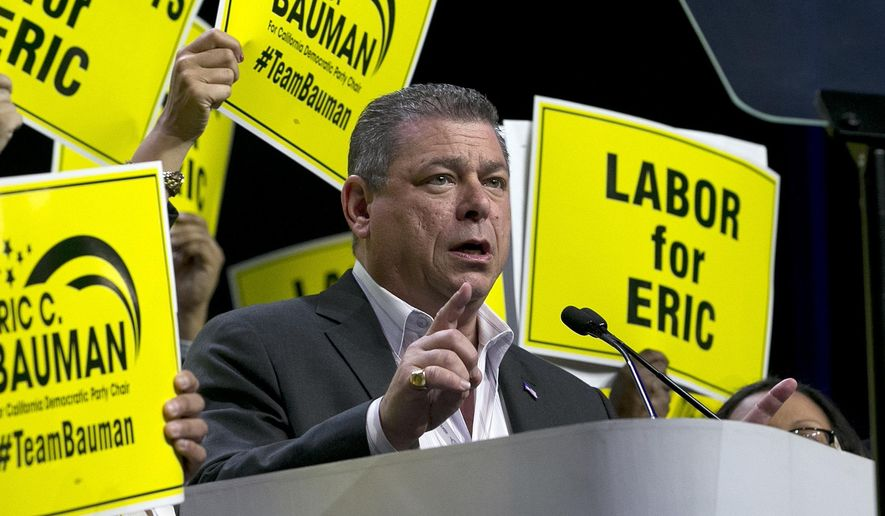 Eric Bauman, who is running to head the California Democratic Party, addresses the California Democratic Party annual convention Saturday, May 20, 2017, in Sacramento, Calif. Bauman is running against Kimberly Ellis to succeed current party chairman John Burton. (AP Photo/Rich Pedroncelli)