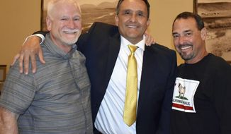 In this April 1, 2017, photo provided by Steve Duncan, retired law enforcement investigators, from left, Brad Berg, Javier Salaiz and Steve Duncan pose for a photograph in San Diego, Calif. Berg, from North Dakota, and the other two agents from California worked together on a drug conspiracy case that led to leaders in a violent Mexican cartel. The investigators are speaking about the case now that the file of an alleged cartel hit man has been made public. (Steve Duncan via AP)
