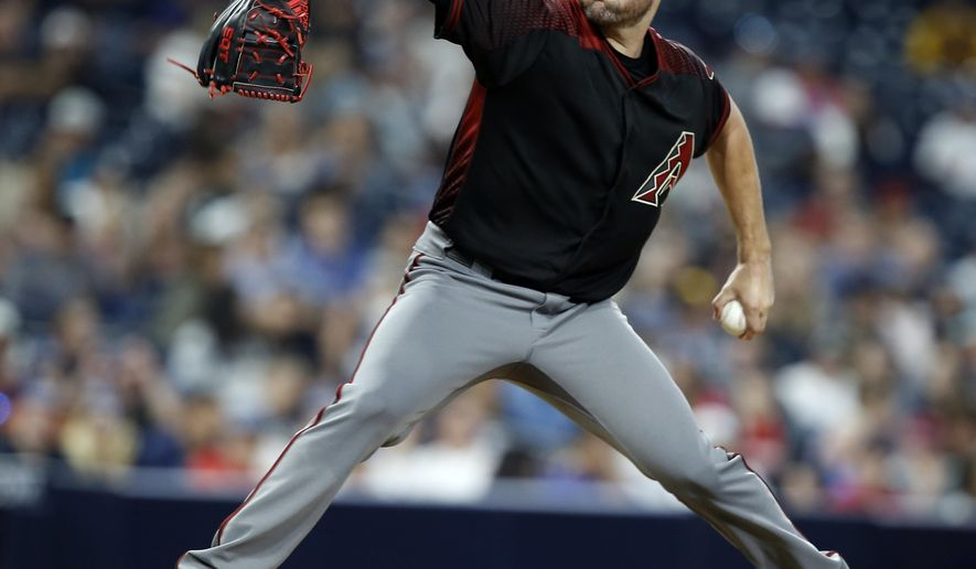Arizona Diamondbacks starting pitcher Robbie Ray throws to the plate against the San Diego Padres during the fifth inning of a baseball game in San Diego, Saturday, May 20, 2017. (AP Photo/Alex Gallardo)