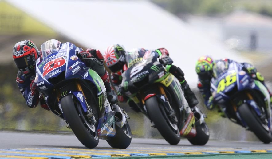 MotoGP rider Maverick Vinales of Spain steers his motorcycle as he is followed by Johann Zarco of France and Valentino Rossi of Italy during the French Grand Prix's race, in Le Mans, western France, Sunday, May 21, 2017. (AP Photo/David Vincent)