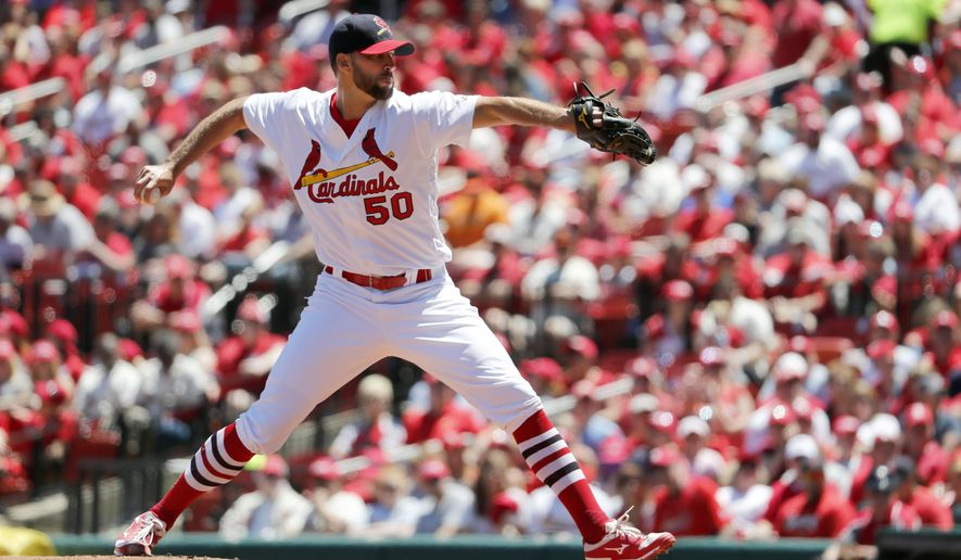 St. Louis Cardinals starting pitcher Adam Wainwright throws during the first inning of a baseball game against the San Francisco Giants Sunday, May 21, 2017, in St. Louis. (AP Photo/Jeff Roberson)