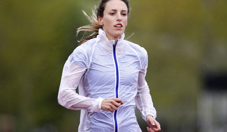 In this May 8, 2017, photo, Gabriele Grunewald trains at Macalester College in St. Paul, Minn. May 8, 2017, St. Paul, Minn. This month, middle-distance runner Gabriele Grunewald has reserved for racing. Next month, chemo. She's delaying her treatments just a little bit in her bid to qualify for the U.S. track and field championships in late June, which she intends to race _ should she make the time standard _ even if she's in the middle of her treatments. (Carlos Gonzalez/Star Tribune via AP)