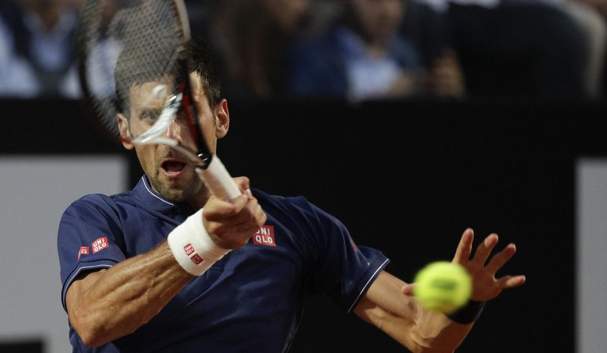 Serbia's Novak Djokovic returns the ball during his semifinal match against Austria's Dominic Thiem at the Italian Open tennis tournament, in Rome, Saturday, May 20, 2017. (AP Photo/Gregorio Borgia)