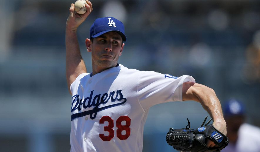 Los Angeles Dodgers starting pitcher Brandon McCarthy throws to the plate during the first inning of a baseball game against the Miami Marlins, Sunday, May 21, 2017, in Los Angeles. (AP Photo/Mark J. Terrill)
