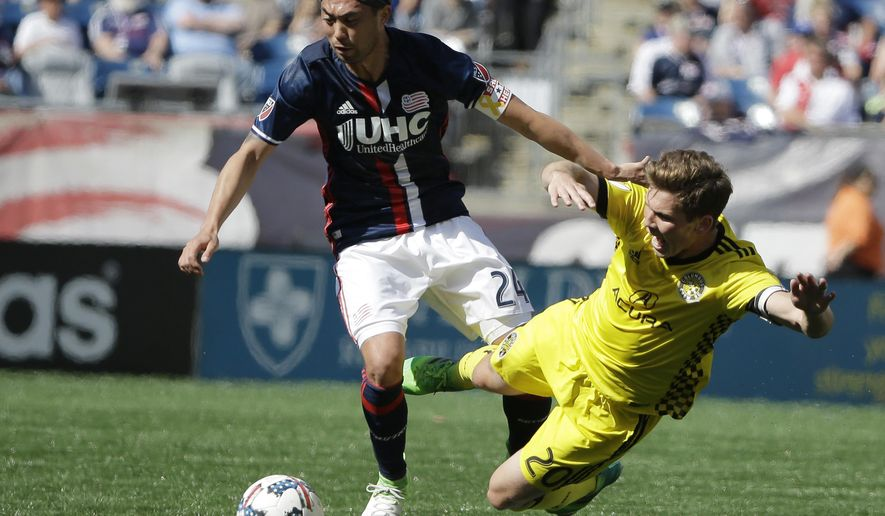 New England Revolution midfielder Lee Nguyen, left, and Columbus Crew midfielder Will Trapp, right, pursue the ball during the second half of an MLS soccer game, Sunday, May 21, 2017, in Foxborough, Mass. The Revolution won 2-1. (AP Photo/Steven Senne)