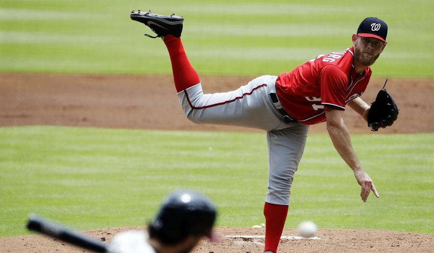 Washington Nationals starting pitcher Stephen Strasburg throws to Atlanta Braves' Dansby Swanson in the first inning of a baseball game in Atlanta, Sunday, May 21, 2017. (AP Photo/David Goldman)